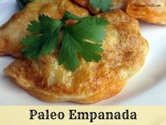 Paleo Empanadas - one of my favorite recipes! The dough is golden, flaky, and crispy. The filling inside: savory and spiced meat.