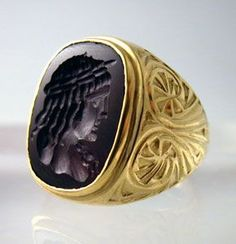 Gold Ring with a Roman Carnelian Intaglio Depicting the Bust of Antinuous 100-300 A.D.