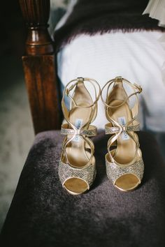 Gold Jimmy Choo peep toe bridal shoes / sandals - Image by Ellie Gillard - Vera Wang Leah gown from Browns Bride for wedding at Syon Park London with a white colour scheme and hydrangea