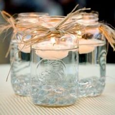 Mason Jars and Candles Keep it simple and use floating candles as your centerpiece. They'll glisten in clear Mason jars. Mason Jars and Candles Keep it simple and use floating… Party Planning, Wedding Planning, Deco Champetre, Do It Yourself Wedding, Mason Jar Centerpieces, Simple Centerpieces, Centerpiece Ideas, Easy Decorations, Country Wedding Centerpieces