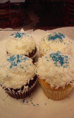 Coconut snowballs on vanilla and coconut cupcakes.