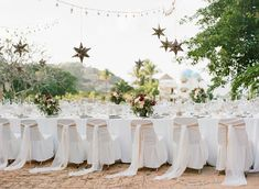 Star-Shaped Lanterns Over Table  Photography: Carrie King Photographer Read More: http://www.insideweddings.com/weddings/destination-rehearsal-dinner-and-welcome-party-in-sayulita-mexico/1045/