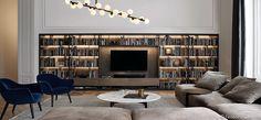 Blue velvet chairs, lighting, gray sectional, built-in shelves. All awesome.