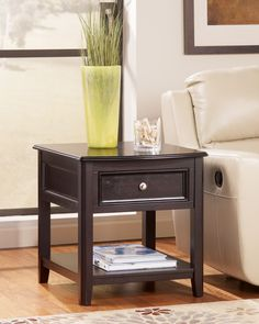 """Ashley Carlyle T771-3 Signature Design Rectangular End Table - Rectangular End Table Featuring a Dark rich """"almost black finish"""" Made with select veneers and hardwood solids"""
