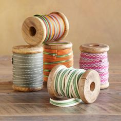 "COUNTRY STORE RIBBONS S/5 -- Wooden spools of brightly striped cotton and polyester ribbons tie up presents, party napkins or ponytails! Imported. Exclusive. 1/2""W ribbons, 8 to 10 yards on each spool. Set of 5."