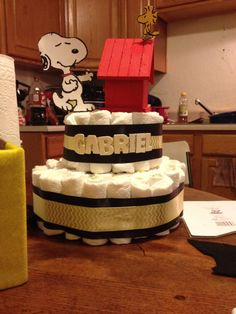 Snoopy diaper cake.. Bir house from Walmart 5.00 pair 1.50 and Snoopy and wood stock from a greeting card...