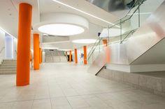 Fantastic University design, featuring bright orange colours and natural stone tiles.