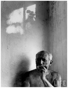 Pablo Picasso, bare-chested & smoking cigarette Gjon Mili Life
