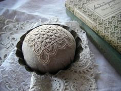 Handmade linen lace pincushion.  Great idea for DIY project