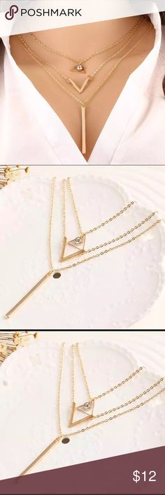 "V for Love Necklace A golden wrap around chain link necklace with three levels, and a golden triangle with gemstone, a ""V"" for ""Victoria"", a golden rod which dangles below. A nice addition to your jewelry collection. Jewelry Necklaces"