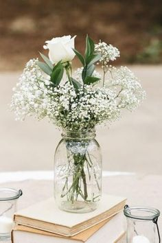 Baby's breath and roses in a mason jar—a simple, affordable wedding centerpiece {Photo by J. Masciana Photography via Project Wedding} by jaclyn