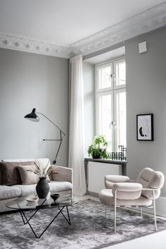 I can't get over the wall colors in this home. They are not that shouting or daring, but I love the way they are combined. The pale pink bedroom walls come peeking through the light grey living room. Pale Pink Bedrooms, Pink Bedroom Walls, Luxury Homes Interior, Home Interior Design, Living Room Grey, Living Room Decor, White Armchair, Woman Bedroom, Living Room Remodel