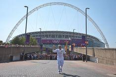Former World Cup winning footballer Torchbearer 037 Gordon Banks carries the Olympic Flame...