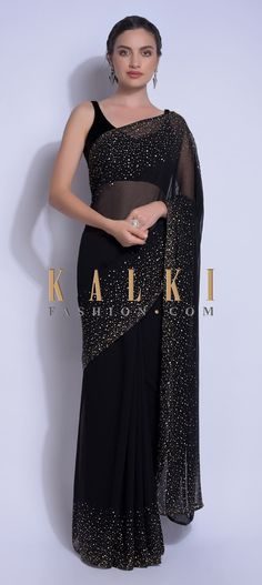 Buy Traditional Indian Clothing Ink Black Saree In Georgette With Kundan Work On The Border And Pallu Online - Kalki Fashion Indian Fashion Dresses, Dress Indian Style, Indian Designer Outfits, Indian Outfits, Saree Fashion, Indian Designer Sarees, Designer Dresses, Trendy Sarees, Stylish Sarees
