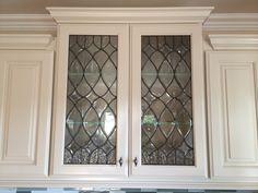 Beveled glass inserts for my kitchen cabinets. Done by SGO Designer Glass  www.OverlayArtGlass.com