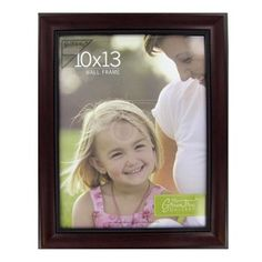 "This Mahogany Wall Frame is perfect for displaying 10 x 13 photos.    	The outside dimensions of the 1 5/8"" wide frame are 12 1/2"" wide x 15 5/8"" tall x 7/8"" thick.    	Please note that the hanging hardware is not included with this frame."