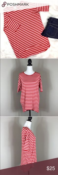 LuLaRoe Pink & Red Striped Irma LuLaRoe Pink & Red Striped Irma. Size XXS fits more like a small these run large. Approximate measurements flat laid are 21' front length, 32' back length, and 23' bust. Pre-owned condition with some basic wash wear and has some piling through the shirt. The piling is not heavy but it is there as most LuLaRoe pieces get. No holes no stains. Washed pre LuLaRoe instructions.  ❌I do not Trade 🙅🏻 Or model💲 Posh Transactions ONLY LuLaRoe Tops Tunics