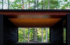 Johnsen Schmaling Architects has completed a family retreat in rural Wisconsin featuring blackened pine cladding, concrete floors and wide-span glass doors Modern Outdoor Living, Carport Garage, Inside Outside, Concrete Floors, Design Awards, Cladding, Black House, Glass Door, Wisconsin