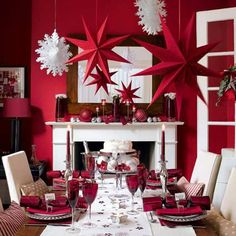 Even if you don't have a bright red dining room, you can still create a dramatic and sophisticated Christmas table setting. Choose a simple high-contrast color scheme and go from there. Bright red and white accessories create a very festive atmosphere, and by sticking with a simple color scheme the entire room works together.