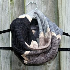 Easy in-the-round knitting with bold chevrons will yield you a colorful accessory that is perfect for topping off your cool weather outfits. This cowl is knit in the round, using a provisional cast on, and the two ends are grafted together.