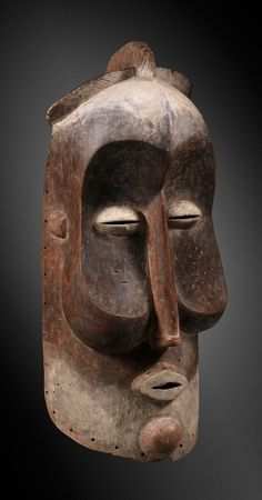 Africa | Helmet mask from the Suku people of DR Congo | Wood and pigment