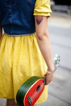Love the uke and the tattoo as well...Even the dress.  The whole look!!!