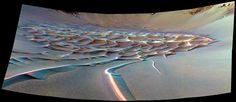 """As the rover Opportunity crept into """"Endurance Crater,"""" it captured this false-color image of the dramatic dune field on the crater floor. Sinuous tendrils of sand less than 1 meter high extend from the main dune field toward the rover 