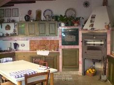 kitchen in a home in Sciacca, Sicily.  I've never seen an oven like this one.