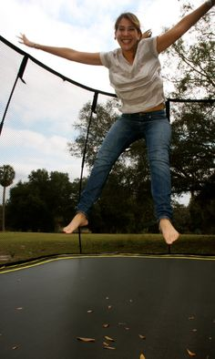 Up she goes on a Springfree Trampoline!