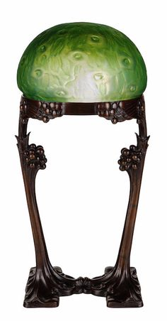 Gustave Gurschner and Loetz, patinated-bronze and iridescent glass lamp, circa 1900, unsigned, height 24 1/2in  |  SOLD $12,500 New York, 2012