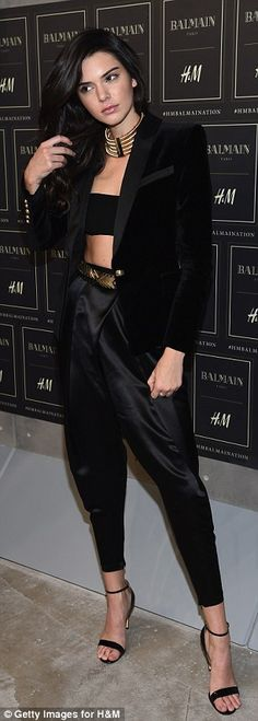 Model muse: Kendall opted for a bandeau top and satin harem pants with stiletto heels...