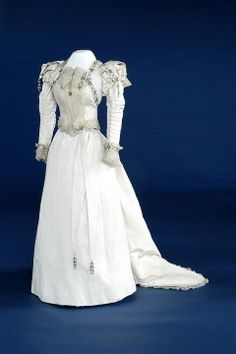 c. 1880 English wedding dress.  Two piece white corded silk wedding dress trimmed with gold beads and pearls. The Bowes Museum: Wedding Dress