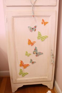 mod podge butterflies out of paper, with pics glued over