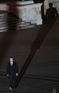 French President-elect Emmanuel Macron casts a shadow as he walks towards the stage to address his supporters at the Louvre Palace in Paris, on Sunday May 7, 2017. The centrist was elected France's next president, putting a 39-year-old political novice at the helm of one of the world's biggest economies and slowing a global populist wave. (AP Photo/Christophe Ena, Pool)