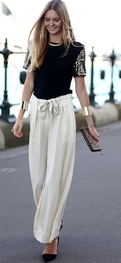 palazzo pants, gold cuffs, and sequinned sleeve tee... a modern girl's choice for evening wear.