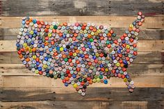 Americana USA map from old bottle caps on recycled pallet oak.