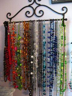 "Use a 24"" wrought iron towel bar for necklace storage"