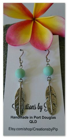 Check out this item in my Etsy shop https://www.etsy.com/au/listing/473378836/feather-earrings-with-mint-silicone-bead