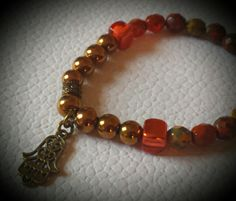 Red beads and goldplated hematite with Hamsa