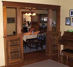 This is pretty much exactly the style I want to add between my living room and library; wood framed, glass doors, not too high, columns. San Diego Woodworking - Craftsman House Gumwood Colonnade - South Park - San Diego, CA, United States