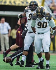 Missouri Tigers defensive lineman Harold Brantley (90) and Missouri Tigers defensive lineman Lucas Vincent (96) celebrate after Brantley recovered a fumble in the first quarter during the University of Missouri and Univeristy of Minnesota Citrus Bowl football game on Thursday, January 1, 2015, near Orlando, Florida.