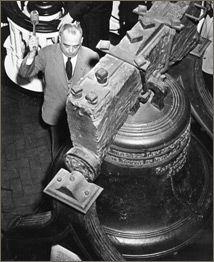 Philadelphia Mayor Bernard Samuels strikes the Liberty Bell in celebration of Germany's unconditional surrender, V-E Day.