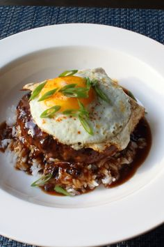 "hawaiian food recipes ""This amazing Hawaiian comfort food classic is made by topping rice with a fried burger, which is then smothered with a rich, brown gravy and finished with a Egg Recipes For Dinner, Easy Egg Recipes, Entree Recipes, Meat Recipes, Mexican Food Recipes, Cooking Recipes, Hawaii Food Recipes, Chef John Recipes, Dinner Ideas"
