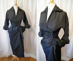 On Hold Vixen 1950's black taffeta wrap front sarong style 3/4 sleeve hourglass cocktail dress timeless bombshell pin up girl - size Medium. $298.00, via Etsy.