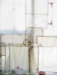 Patchwork lace curtains using vintage doilies and hankies
