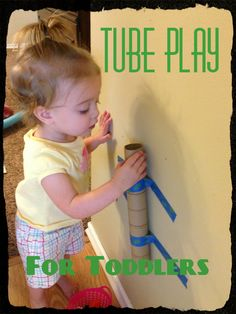 """Tube and Pom-Pom Play for Toddlers... I just need some painters tape (Safe for walls)... and to save some tubes. This would be easy to set up several """"stations"""" on a rainy day."""
