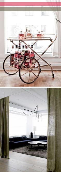 Tea cart as mini-bar and sheer curtain as room divider. I like.