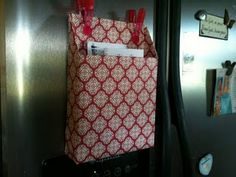 This is a great idea!  A cereal box covered in scrapbook paper to hang the mail on the fridge!  Or you could use this idea for paper, books, or anything that needs organization.  :)