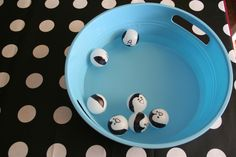 Rescue Penguin game. Ping Pong balls with penguin face drawn on them. The original post just had toddlers playing with the balls in water. I'm wondering if my residents could fish them out of a bowl with spoons?