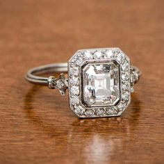 Rings Vintage Antique emerald cut surrounded by a halo old mine diamonds. - A rare antique cushion cut diamond, cut circa that has been mounted into a stunning handmade platinum mounting. A halo surrounds the center diamond. Vintage Style Engagement Rings, Platinum Engagement Rings, Vintage Rings, Halo Engagement, Tiffany Engagement, Vintage Diamond, Diamond Bands, Diamond Cuts, Bling Bling